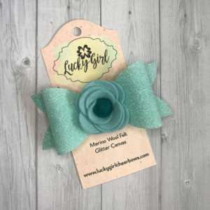 Modern bow with felt flower