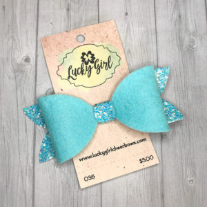 Modern bow made with felt and glitter canvas