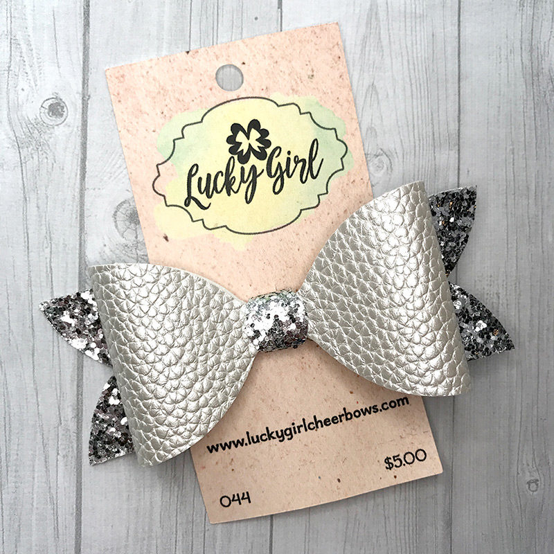 Modern bow with glitter and leatherette